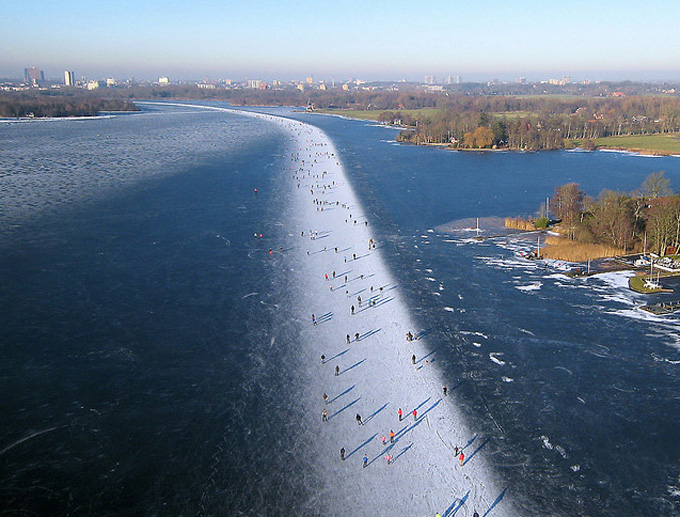 Ice skating on Paterswoldse Meer, a lake just South of the city of Groningen in the Netherlands.