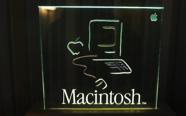 The logo for the original 128K Macintosh computer is displayed at the Vintage Mac Museum in Malden