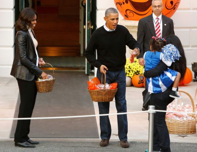 Obama greet children on the South Lawn for a Halloween trick-or-treating celebration in Washington